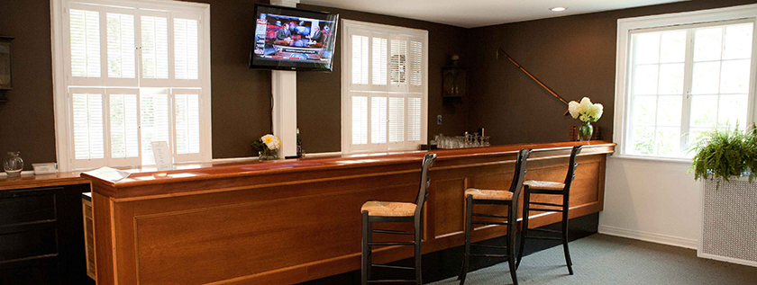 The Bentley Room offers a casual atmosphere, attractive bar, a television and a place to kick back and unwind.
